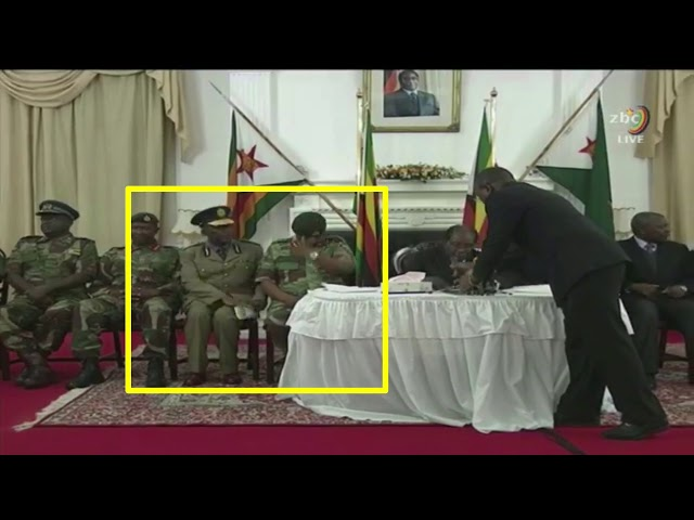 Chiwenga exchanging papers at Robert Mugabe unResignation Speech
