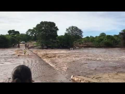 Zimbabwe floods sweep away car.