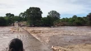 Zimbabwe floods sweep away car.