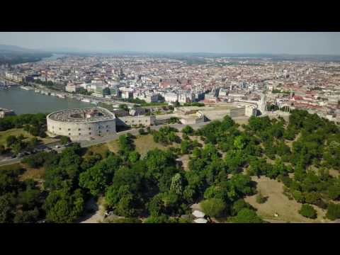 Aerial view of Gellert Hill / Statue of Liberty / Citadel / Castle District of Budapest in 4K/UHD