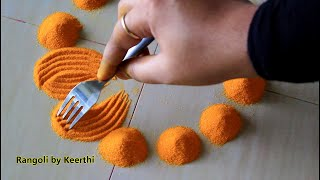 Simple diya rangoli for diwali using fork l diwali special rangoli design l Rangoli by Keerthi
