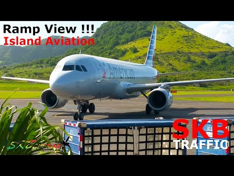 American Airlines A320 arriving from Charlotte - 737-800 departing to Miami @ St. Kitts (Ramp View)