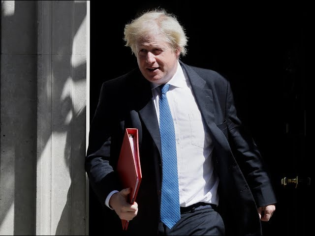 Britain and the European Union insisted Monday that their divorce negotiations remain on track after the resignation of the U.K.'s top Brexit official shook Prime Minister Theresa May's fragile grip on power. (The Associated Press)