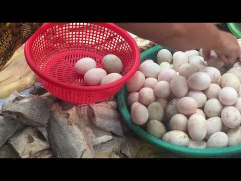 Market street food in Asia, Cambodian street market, Dried fishes, eggs, meat, and seafoods