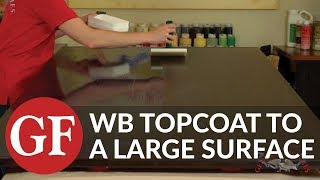 How to Apply Water Based Topcoat to a Large Surface With a Paint Pad Applicator