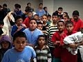 From youtube.com: Migrant children {MID-301185}