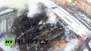 Drone captures fire-fighters battling Moscow library blaze aftermath