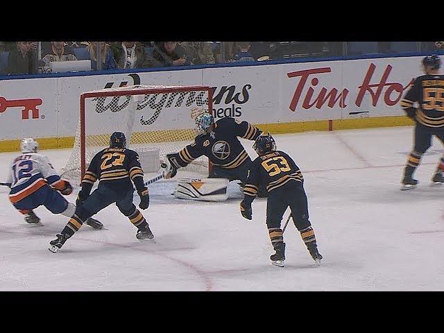 Carter Hutton robs Josh Bailey with his paddle