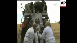 Soyuz capsule with 2 Russian cosmonauts and US astronaut lands