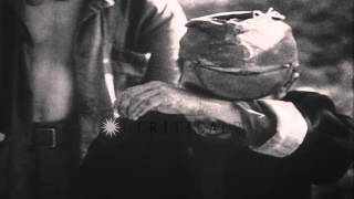 Two United States Marines of 1st Battalion, 7th Regiment capture Japanese soldier...HD Stock Footage