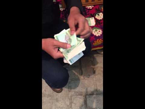 Counting cash in Uzbekistan