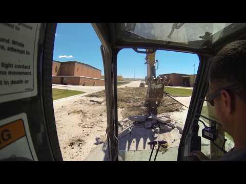 Excavator loading concrete