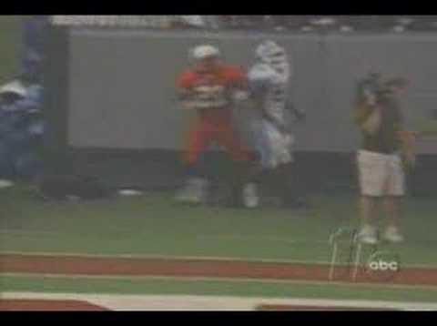 Dexter Reid shoves cameraman