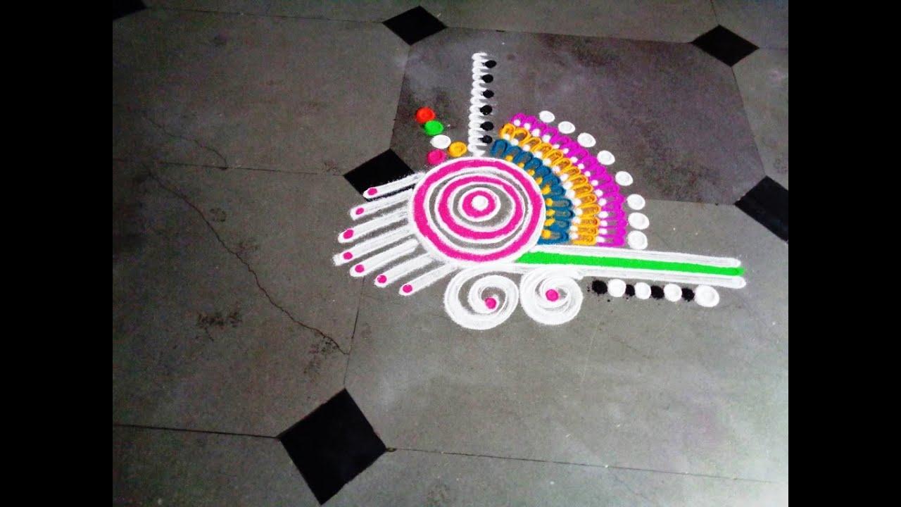 Beautiful fancy latest rangoli youtube for Door entrance rangoli designs