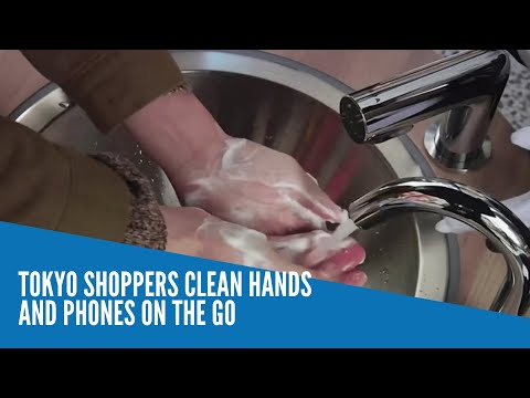 Tokyo shoppers clean hands and phones on the go