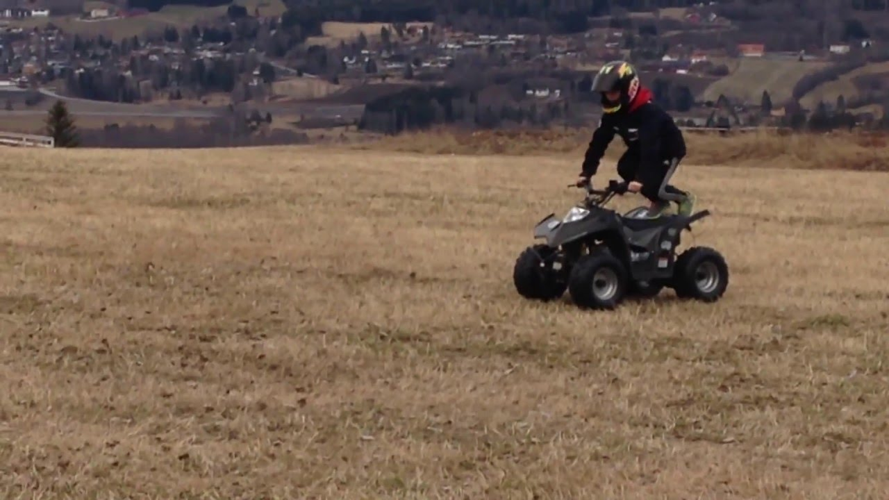 wheelie on a 90cc atv [ 1280 x 720 Pixel ]