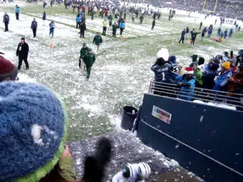 Jets Football Player, Shaun Ellis, throws Gigantic Snowball at Pesty Seahawks Fan