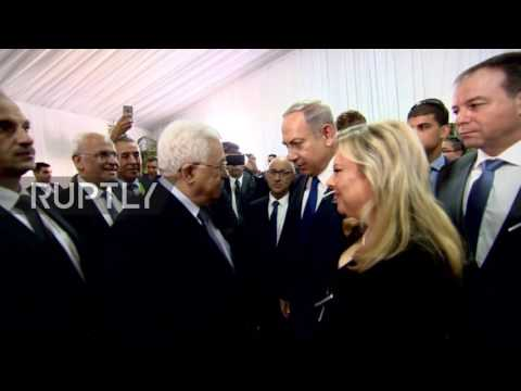 Israel: Abbas and Netanyahu exchange 'historic' hand shake at Peres funeral