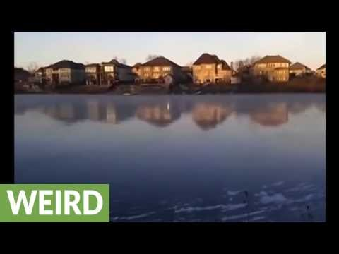 Rock thrown onto frozen lake makes coolest sound ever