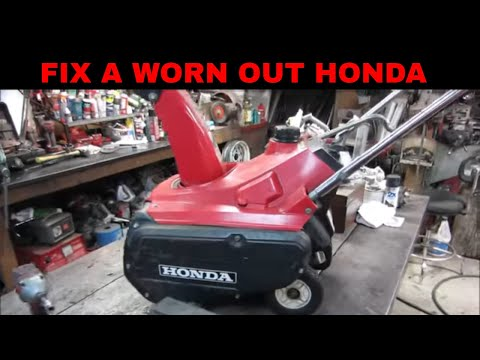 Honda snowblower not t throwing snow, lets fix it by replacing the paddles and scraper.