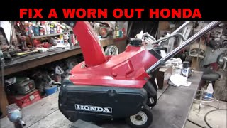 Honda snowblower not throwing snow, lets fix it by replacing the paddles and scraper.