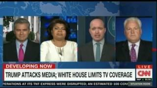 W Blizter struggles to control a debate between Jim Acosta and a Trump supporter over Press access
