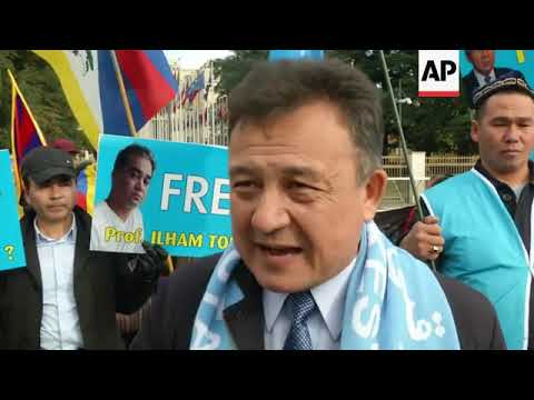 Uighurs' supporters march in Geneva as China faces rights review at UN