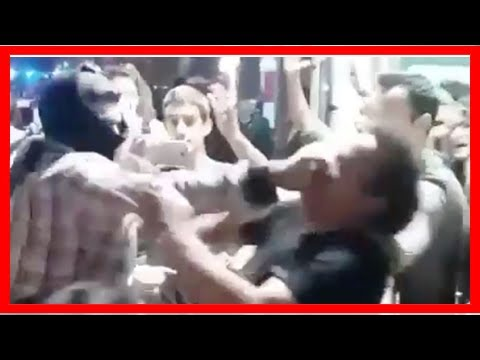 US Newspapers - Spanish unity protester punches catalan independence supporter in brutal footage