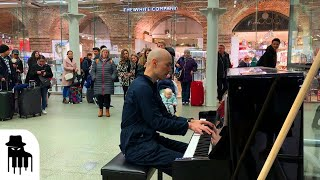 Download Disguised concert pianist stuns unsuspecting travelers Mp3 and Videos