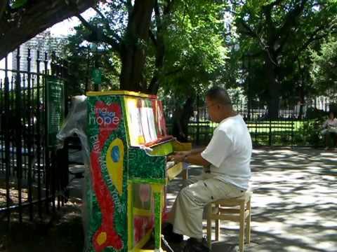 Manny  Panta, City Hall Park, New York City, June 21, 2010-Play me I'm yours art Installation