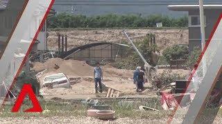 Japan struggles to cope with aftermath of floods, landslides