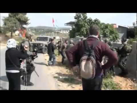israeli soldier in palestine village