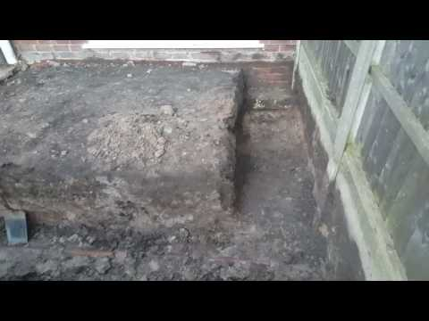 a drain found in a concrete house extension foundation