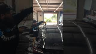 Tintstitute Trainee Heat Shrinking a Tesla Model 3 Back Window