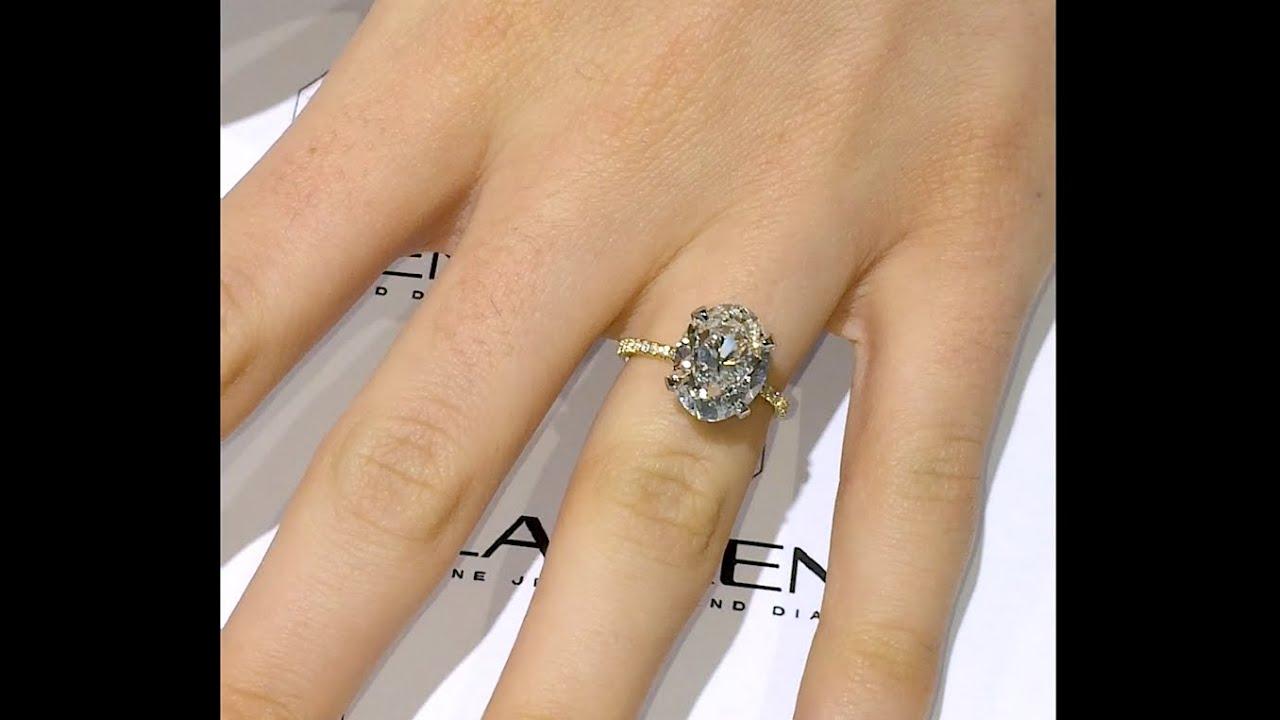 side a striking gia oval diamond ring engagement laurel certified with rings halo view cut