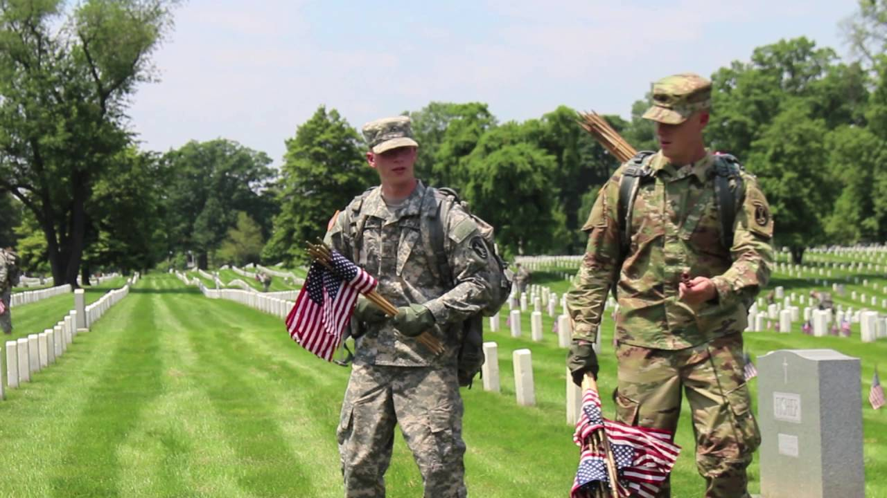 Old Guard soldiers place flags to honor the fallen