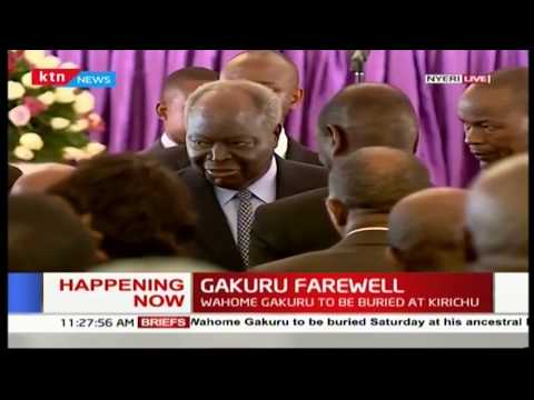 Former President Mwai Kibaki attends the late Wahome Gakuru's burial ceremony