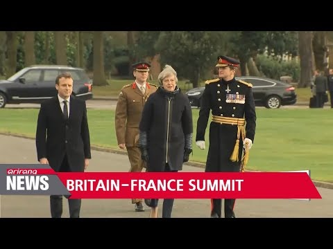 Leaders of Britain and France meet to boost ties amid Brexit talks