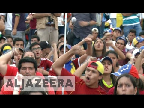Thousands of Venezuelans take to streets in anti-government protests