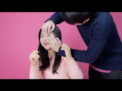 Korean girls try to open their eyes