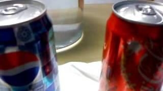 Sinking and floating soda cans.MP4