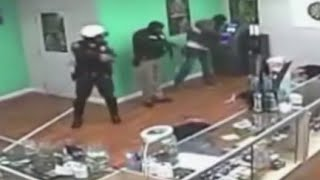 Mar. 15/16-Officers Charged For Stealing In Pot Shop Raid