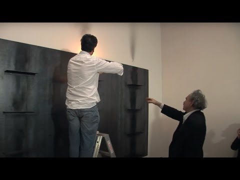 Artist Jannis Kounellis installing 'Untitled 1984/87'