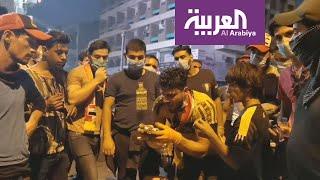 متظاهر عراقي: ستة ملثمين يرمون قنابل غاز إيرانية الصنع تجاه المتظاهرين