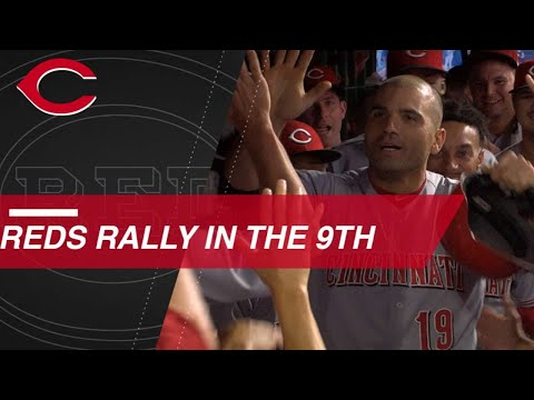 Votto caps Reds' 7-run rally to take lead in 9th