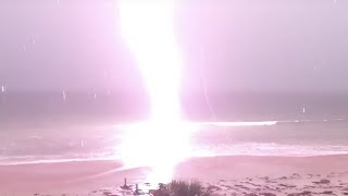 Lightning Bolt Strikes Close To Beach Shore (Storyful, Crazy Weather)