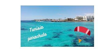 Parachute into the sea. -