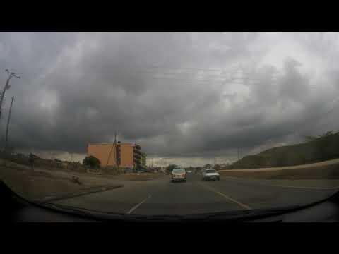 Driving through Kitengela Town Center during a cloudy day
