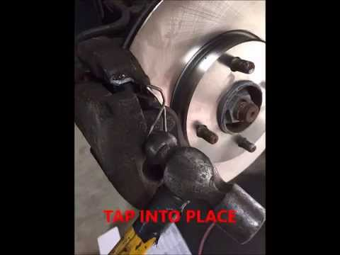 replace ford focus front brake pads and rotors - youtube