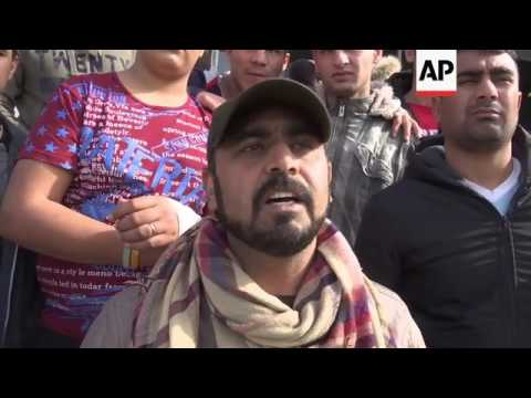 Protesters confront ministers at Athens migrant camp